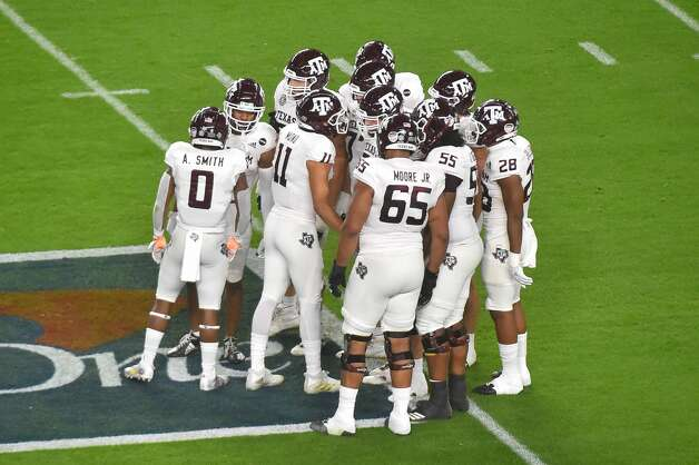 MIAMI GARDENS, FL - JANUARY 02: The Texas A&M Aggies huddle in the first quarter of the game against the North Carolina Tar Heels at Hard Rock Stadium on January 2, 2021 in Miami Gardens, Florida. (Photo by Eric Espada/Getty Images) Photo: Eric Espada/Getty Images / 2021 Getty Images