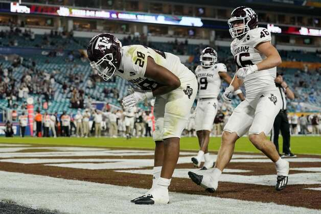 Texas A&M running back Isaiah Spiller (28) takes a bow after scoring a touchdown during the first half of the Orange Bowl NCAA college football game against North Carolina, Saturday, Jan. 2, 2021, in Miami Gardens, Fla.(AP Photo/Lynne Sladky) Photo: Lynne Sladky/Associated Press / Copyright 2021 The Associated Press. All rights reserved.