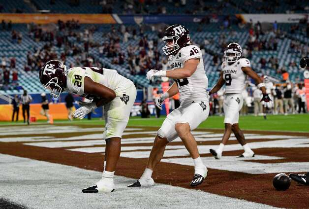 MIAMI GARDENS, FLORIDA - JANUARY 02: Isaiah Spiller #28 of the Texas A&M Aggies celebrates in the endzone after running for a touchdown against the North Carolina Tar Heels in the first quarter of the Capital One Orange Bowl at Hard Rock Stadium on January 02, 2021 in Miami Gardens, Florida. (Photo by Mark Brown/Getty Images) Photo: Mark Brown/Getty Images / 2021 Getty Images