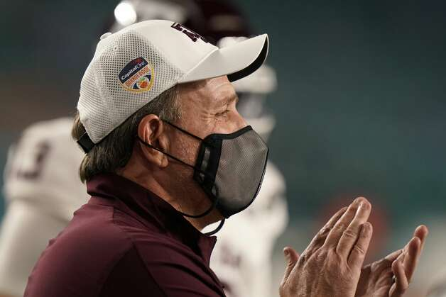 Texas A&M head coach Jimbo Fisher watches players warm up before the Orange Bowl NCAA college football game against North Carolina, Saturday, Jan. 2, 2021, in Miami Gardens, Fla.(AP Photo/Lynne Sladky) Photo: Lynne Sladky/Associated Press / Copyright 2021 The Associated Press. All rights reserved.