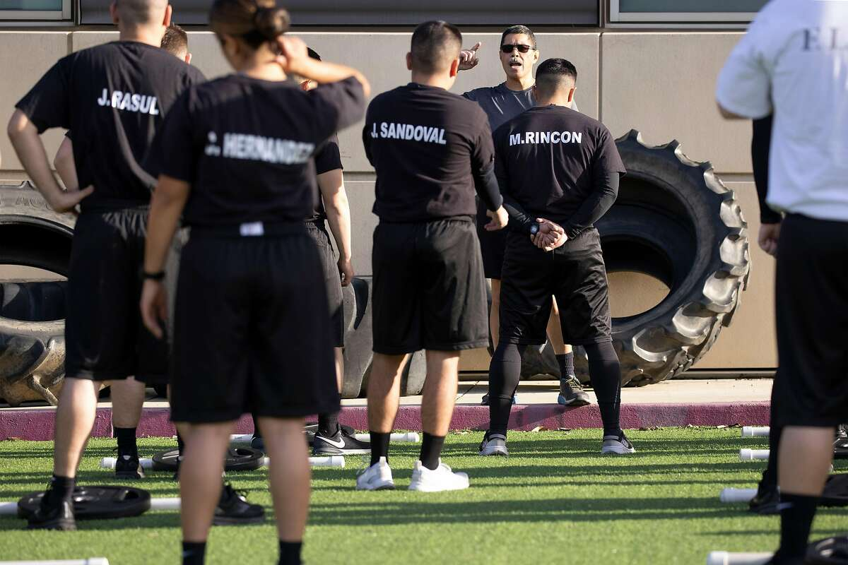 Cadets of the 39th San Jose Police Training Academy work out during their daily training routine last week.