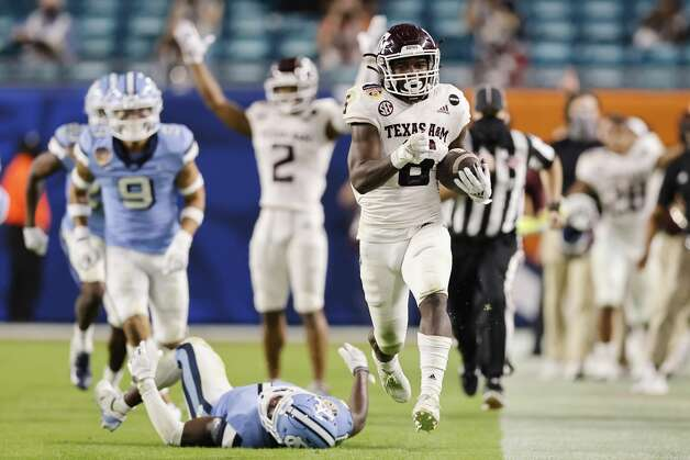 Devon Achane #6 of the Texas A&M Aggies runs for a 76-yard touchdown against the North Carolina Tar Heels during the fourth quarter of the Capital One Orange Bowl at Hard Rock Stadium on January 02, 2021 in Miami Gardens, Florida. (Photo by Michael Reaves/Getty Images) Photo: Michael Reaves/Getty Images / 2021 Getty Images