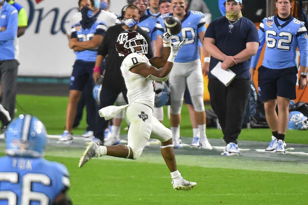 MIAMI GARDENS, FL - JANUARY 02: Ainias Smith #0 of the Texas A&M Aggie makes a catch during the fourth quarter of the Capital One Orange Bowl against the North Carolina Tar Heels at Hard Rock Stadium on January 2, 2021 in Miami Gardens, Florida. (Photo by Eric Espada/Getty Images) Photo: Eric Espada/Getty Images / 2021 Getty Images