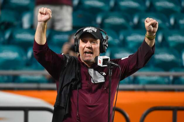 MIAMI GARDENS, FL - JANUARY 02: Head coach Jimbo Fisher of the Texas A&M Aggies celebrates on the podium after defeating the North Carolina Tar Heels 41-27 in the Capital One Orange Bowl at Hard Rock Stadium on January 2, 2021 in Miami Gardens, Florida. (Photo by Eric Espada/Getty Images) Photo: Eric Espada/Getty Images / 2021 Getty Images
