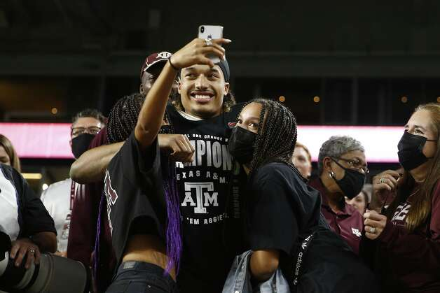MIAMI GARDENS, FLORIDA - JANUARY 02: Kellen Mond #11 of the Texas A&M Aggies celebrates with his family after defeating the North Carolina Tar Heels 41-27 in the Capital One Orange Bowl at Hard Rock Stadium on January 02, 2021 in Miami Gardens, Florida. (Photo by Michael Reaves/Getty Images) Photo: Michael Reaves/Getty Images / 2021 Getty Images