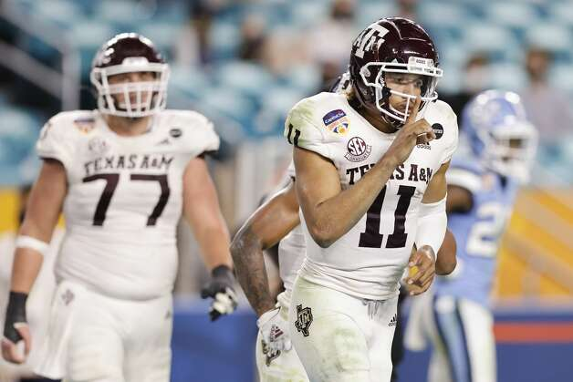 MIAMI GARDENS, FLORIDA - JANUARY 02: Kellen Mond #11 of the Texas A&M Aggies celebrates rushing for a touchdown against the North Carolina Tar Heels during the second half of the Capital One Orange Bowl at Hard Rock Stadium on January 02, 2021 in Miami Gardens, Florida. (Photo by Michael Reaves/Getty Images) Photo: Michael Reaves/Getty Images / 2021 Getty Images
