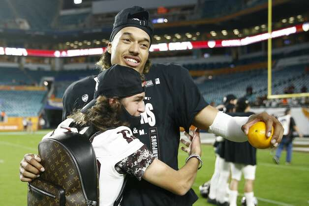 MIAMI GARDENS, FLORIDA - JANUARY 02: Kellen Mond #11 of the Texas A&M Aggies celebrates with Ethan Fisher after defeating the North Carolina Tar Heels 41-27 in the Capital One Orange Bowl at Hard Rock Stadium on January 02, 2021 in Miami Gardens, Florida. (Photo by Michael Reaves/Getty Images) Photo: Michael Reaves/Getty Images / 2021 Getty Images