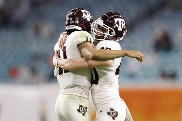 MIAMI GARDENS, FLORIDA - JANUARY 02: Kellen Mond #11 of the Texas A&M Aggies celebrates with Connor Choate #40 against the North Carolina Tar Heels during the second half of the Capital One Orange Bowl at Hard Rock Stadium on January 02, 2021 in Miami Gardens, Florida. (Photo by Michael Reaves/Getty Images) Photo: Michael Reaves/Getty Images / 2021 Getty Images