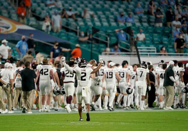 MIAMI GARDENS, FLORIDA - JANUARY 02: Chase Lane #2 of the Texas A&M Aggies celebrates after a touchdown by Devon Achane #6 (not pictured) against the North Carolina Tar Heels in the fourth quarter of the Capital One Orange Bowl at Hard Rock Stadium on January 02, 2021 in Miami Gardens, Florida. (Photo by Mark Brown/Getty Images) Photo: Mark Brown/Getty Images / 2021 Getty Images