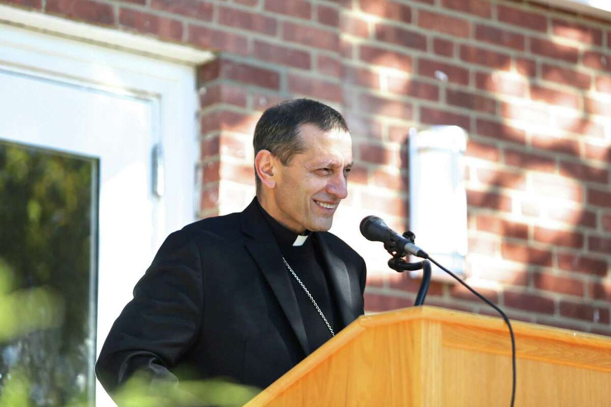 Most Rev. Frank J. Caggiano, bishop of the Diocese of Bridgeport, blesses the building during a ribbon-cutting ceremony for the new Upper School at Greenwich Catholic School Oct. 11, 2016.