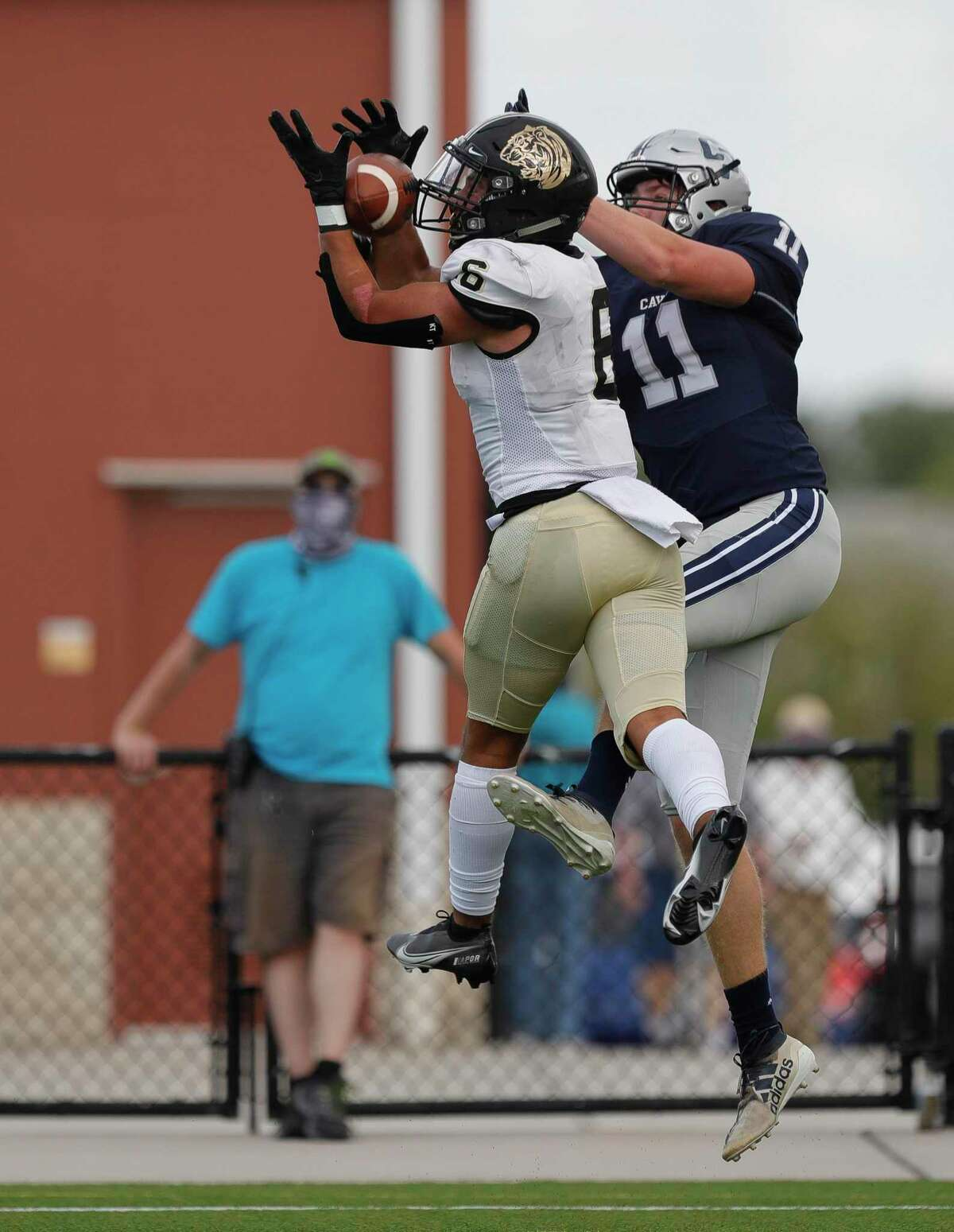 Conroe defensive back Layne O'Dell (6) intercepts a pass intended for College Park tight end Cody Mladenka (11) during the second quarter of a District 13-6A high school football game at Woodforest Bank Stadium, Saturday, Nov. 14, 2020, in Shenandoah.