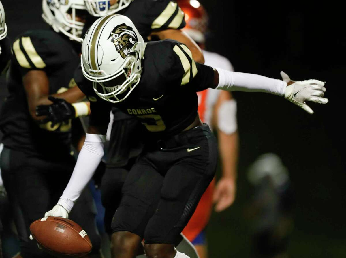 Conroe wide receiver Louis Williams III (3) reacts after catching a 15-yard touchdown pass from quarterback Jalen Williams during the first quarter of a District 13-6A high school football game at Buddy Moorhead Stadium, Friday, Nov. 6, 2020, in Conroe.