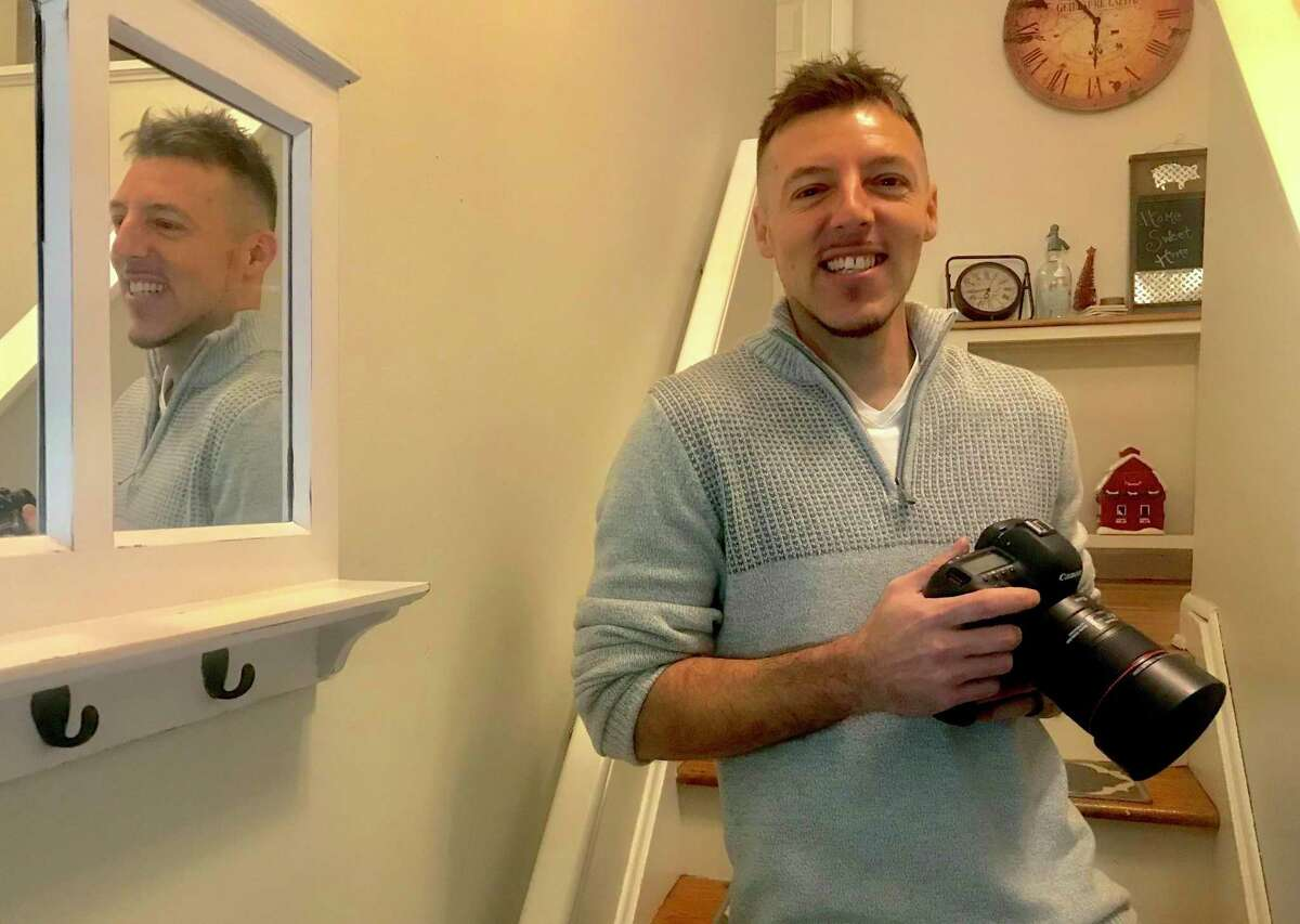 Paul Pontillo, a wedding and food photographer, moved with his wife and three children to a house in Oxford from a small apartment in Bridgeport in February, 2020 - then lost all of his income in the coronavirus shutdown. He's shown in his house on Dec. 31, four days after Trump signed the $900 billion CARES Act 2 stimulus bill.