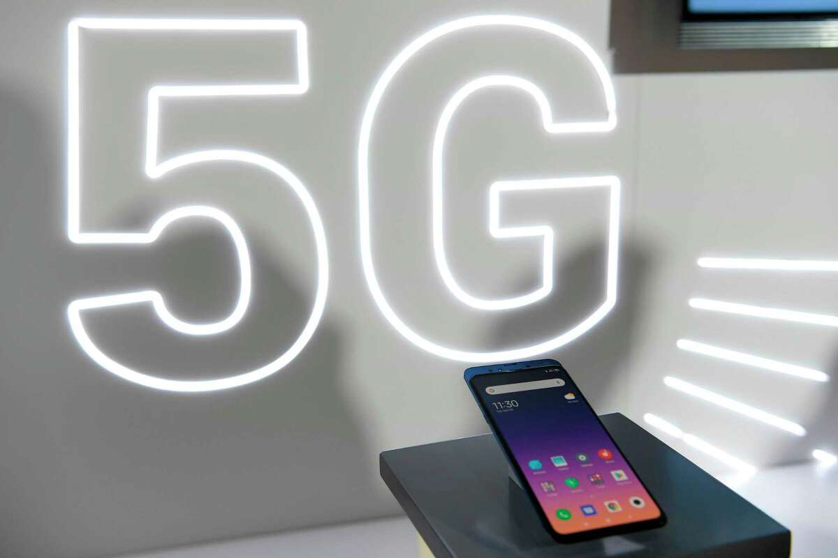 (FILES) This file photo taken in Barcelona on February 24, 2019 shows Chinese electronics company Xiaomi Corporation's new smartphone Mi MIX3 5G displayed at the Mobile World Congress (MWC), on the eve of the world's biggest mobile fair. - The next allocations of frequencies for 5G should not be done without prior assessment of its impact on the environment, recommends the High Council for the Climate on Decmber 19, 2020, while French President refused to postpone the deployment of this technology. (Photo by LLUIS GENE / AFP) (Photo by LLUIS GENE/AFP via Getty Images)