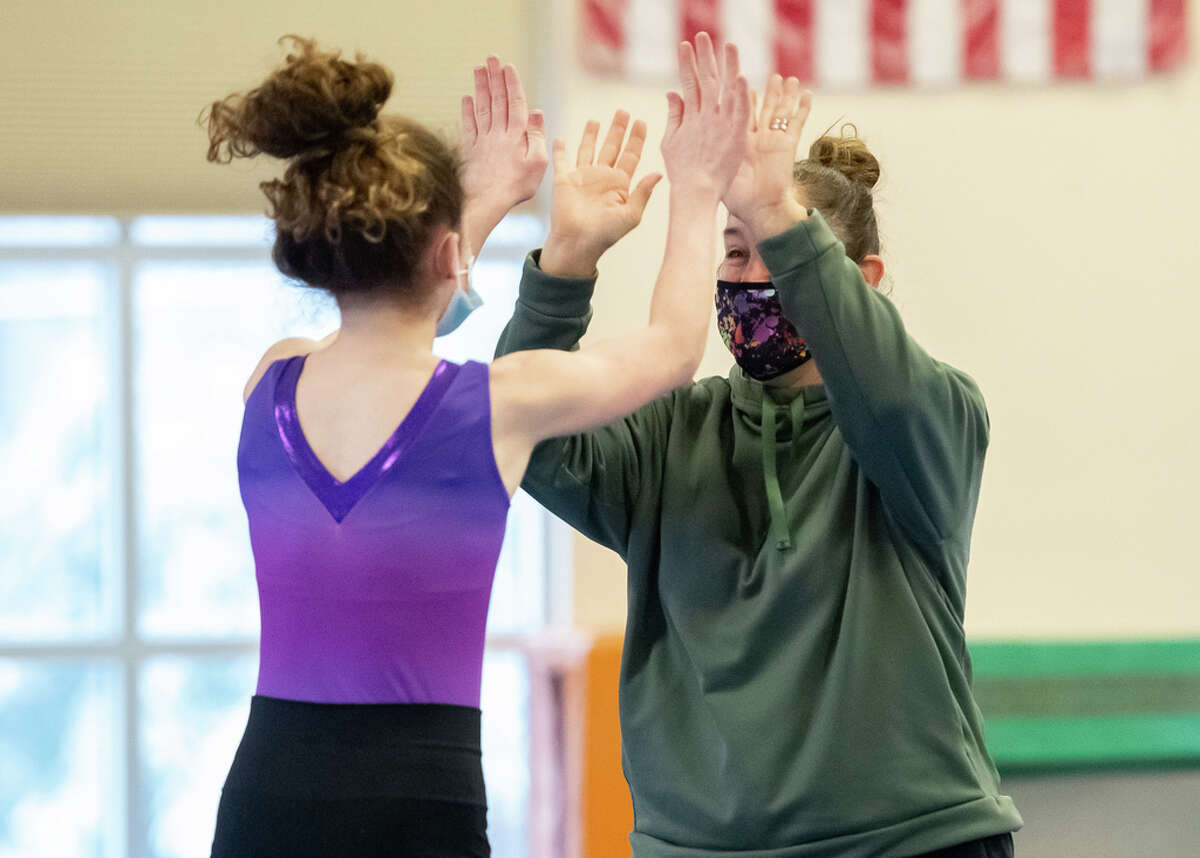 Saratoga gymnastics coach Deborah Smarro praises Alex Endres for her routine on the mat during practice on Saturday, Jan. 2, 2021, at Wilton's YMCA in Saratoga Springs, N.Y. (Jenn March, Special to the Times Union)