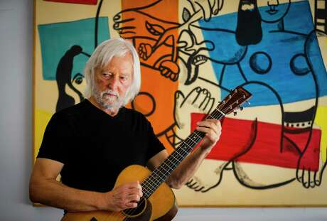 Al Staehely plays his pre-war Martin guitar in his garage studio Tuesday, Aug. 4, 2020, in Houston. Staehely spent years as a touring musician, including playing in the band Spirit in the 1970s, and returned to Houston in the 1980s to being a successful law career. Staehely still performs around Houston, including with his brother as the Staehely Brothers.