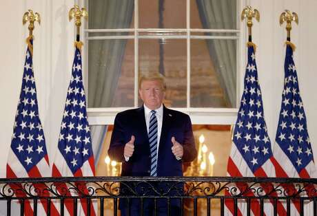 U.S. President Donald Trump gives a thumbs up after returning to the White House from Walter Reed National Military Medical Center on Oct. 5, 2020, in Washington, D.C. Trump spent three days hospitalized for coronavirus. (Win McNamee/Getty Images/TNS)