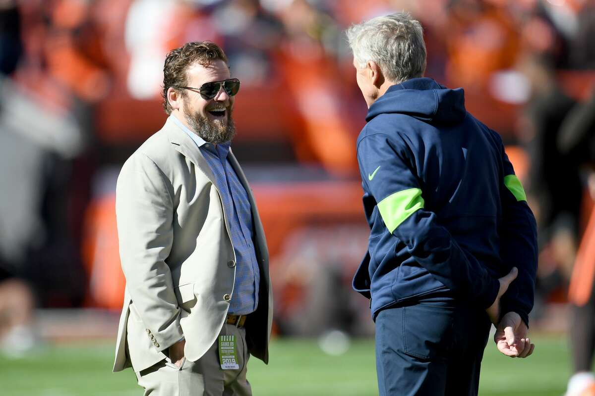 CLEVELAND, OHIO - OCTOBER 13: General manager John Schneider talks with head coach Pete Carroll of the Seattle Seahawks prior to the game against the Cleveland Browns at FirstEnergy Stadium on October 13, 2019 in Cleveland, Ohio. (Photo by Jason Miller/Getty Images)
