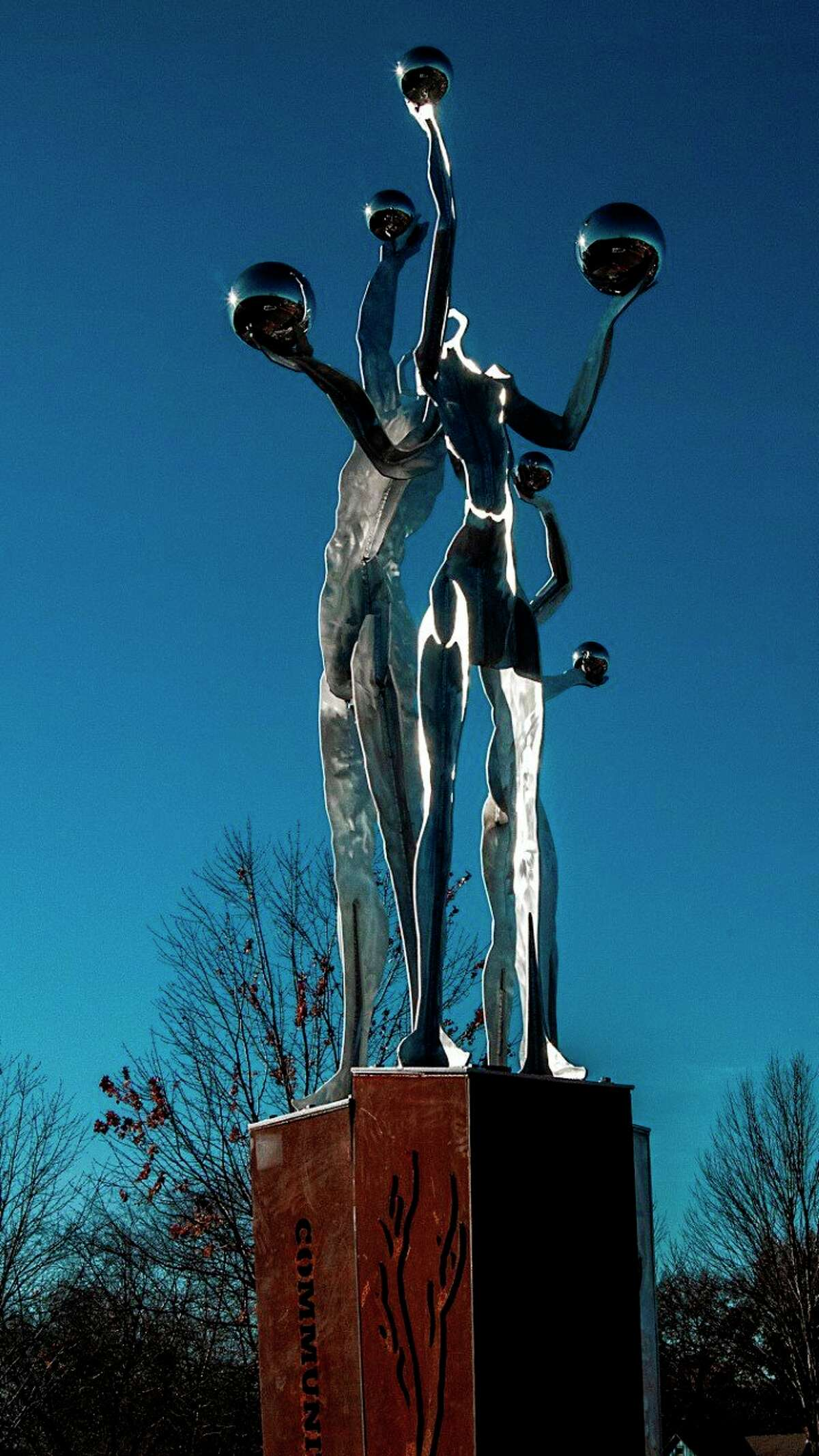 """""""Ascending"""" is a 20-foot tall sculpture, featuring three figures atop individual podiums. Robert Barnum was commissioned to create the piece by community members in Blue Springs, Missouri. (Courtesy photo)"""