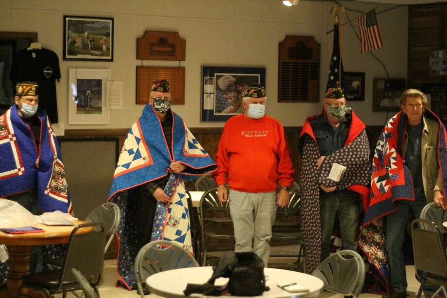 Robert Cromwell (left), Stanley Preidis, Don Vadeboncoeur, Al Syverson and Phil Sakkers pose for a photo after Cromwell, Preidis, Syverson and Sakkers were awarded Quilts of Valor at the Manistee Veterans of Foreign Wars Walsh Post. No. 4499 on Wednesday. Vadeboncoeur nominated the four men. Photo: Kyle Kotecki/News Advocate