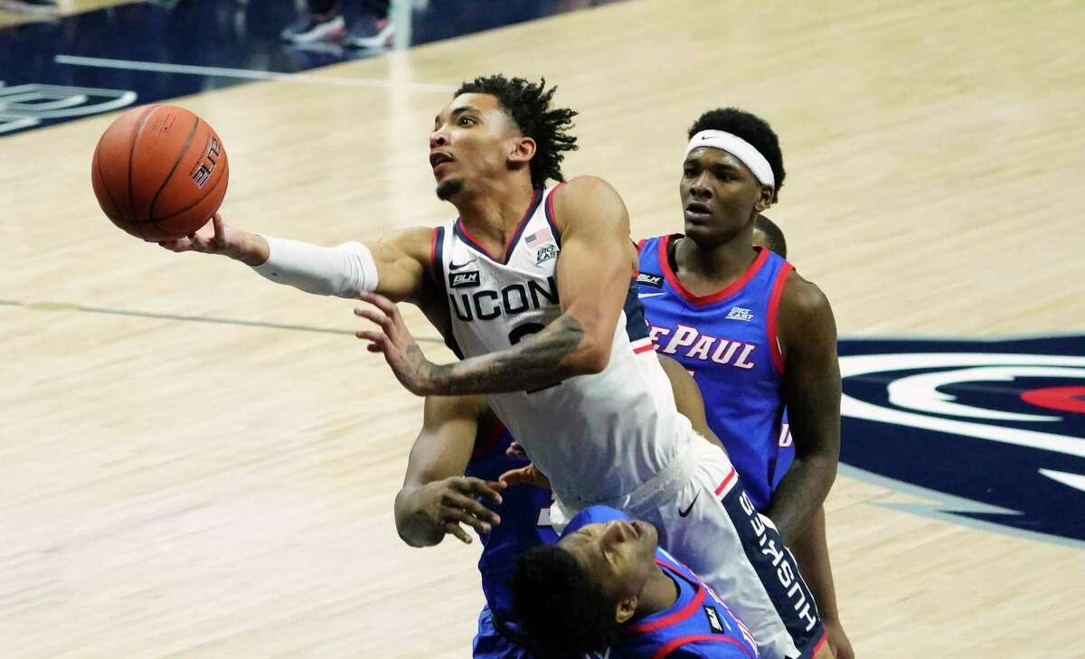 Connecticut guard James Bouknight (2) shoots against DePaul during the first half of an NCAA college basketball game Wednesday, Dec. 30, 2020, in Storrs, Conn. (David Butler II/Pool Photo via AP)