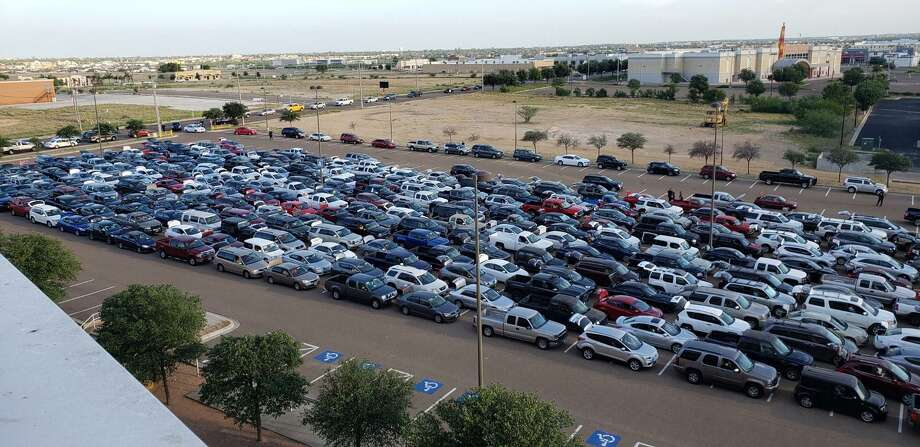 Members of the community affected by the coronavirus pandemic wait in their vehicles as they form lines to receive food during the South Texas Food Bank's COVID-19 Emergency Distribution on May 2 at Sames Auto Arena. Photo: Sames Auto Arena /Laredo Morning Times File