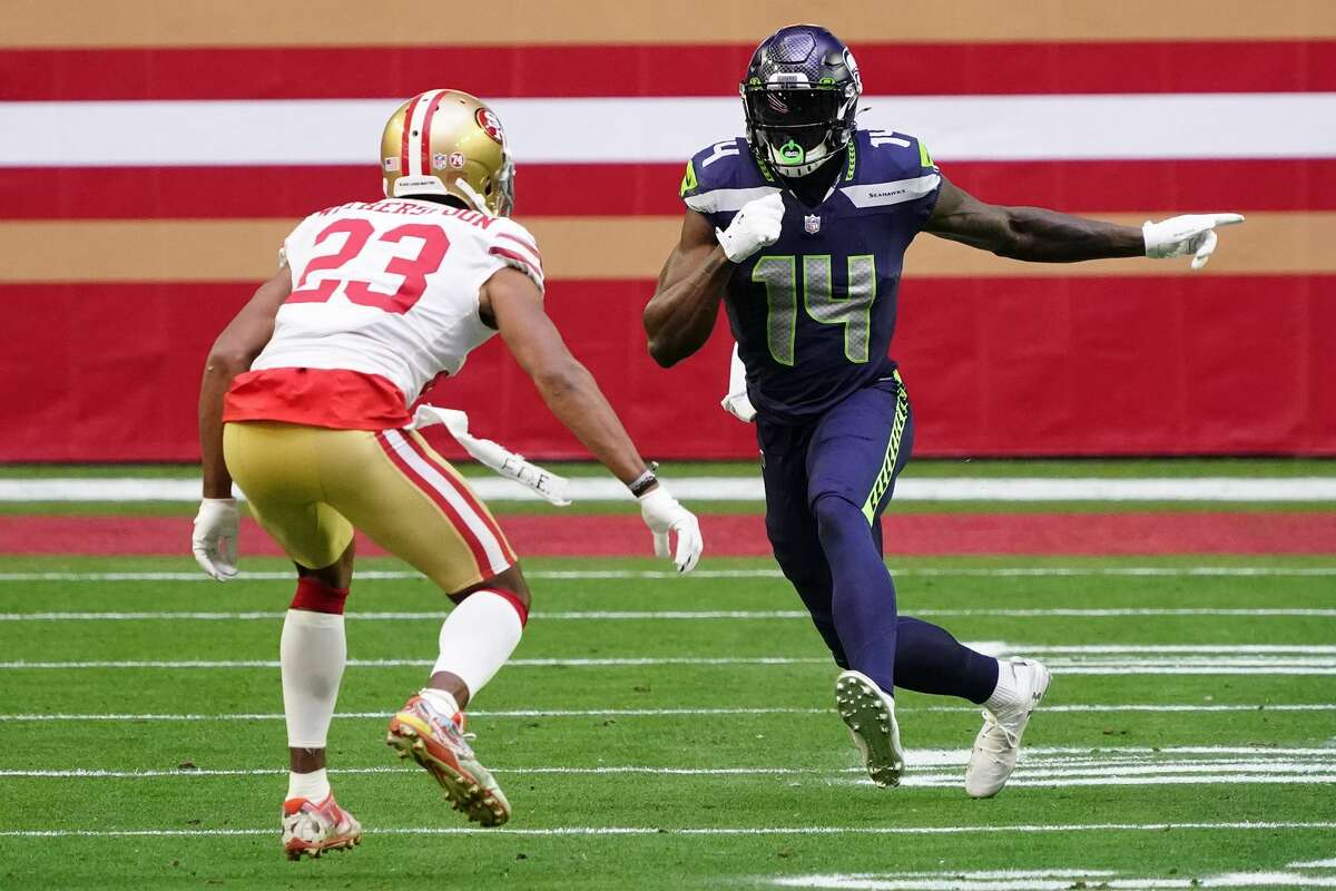 Seattle Seahawks wide receiver DK Metcalf (14) and San Francisco 49ers cornerback Ahkello Witherspoon (23) during the first half of an NFL football game, Sunday, Jan. 3, 2021, in Glendale, Ariz. (AP Photo/Rick Scuteri)
