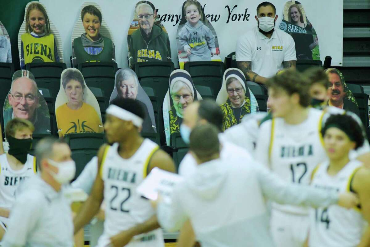 Large photo cutouts of Siena fans are seen propped up in seats at the Alumni Recreation Center on the campus of Siena College, as the men's basketball had their first game of the season on Sunday, Jan. 3, 2021, in Loudonville, N.Y. Siena played and beat Monmouth for also their first win of the season. (Paul Buckowski/Times Union)