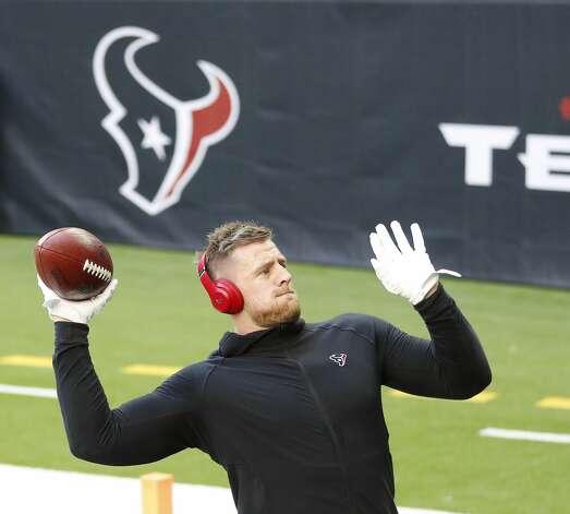 Houston Texans defensive end J.J. Watt throws the ball to kids before the start of an NFL football game Sunday, Jan. 3, 2021, at NRG Stadium in Houston . Photo: Karen Warren/Staff Photographer / © 2021 Houston Chronicle