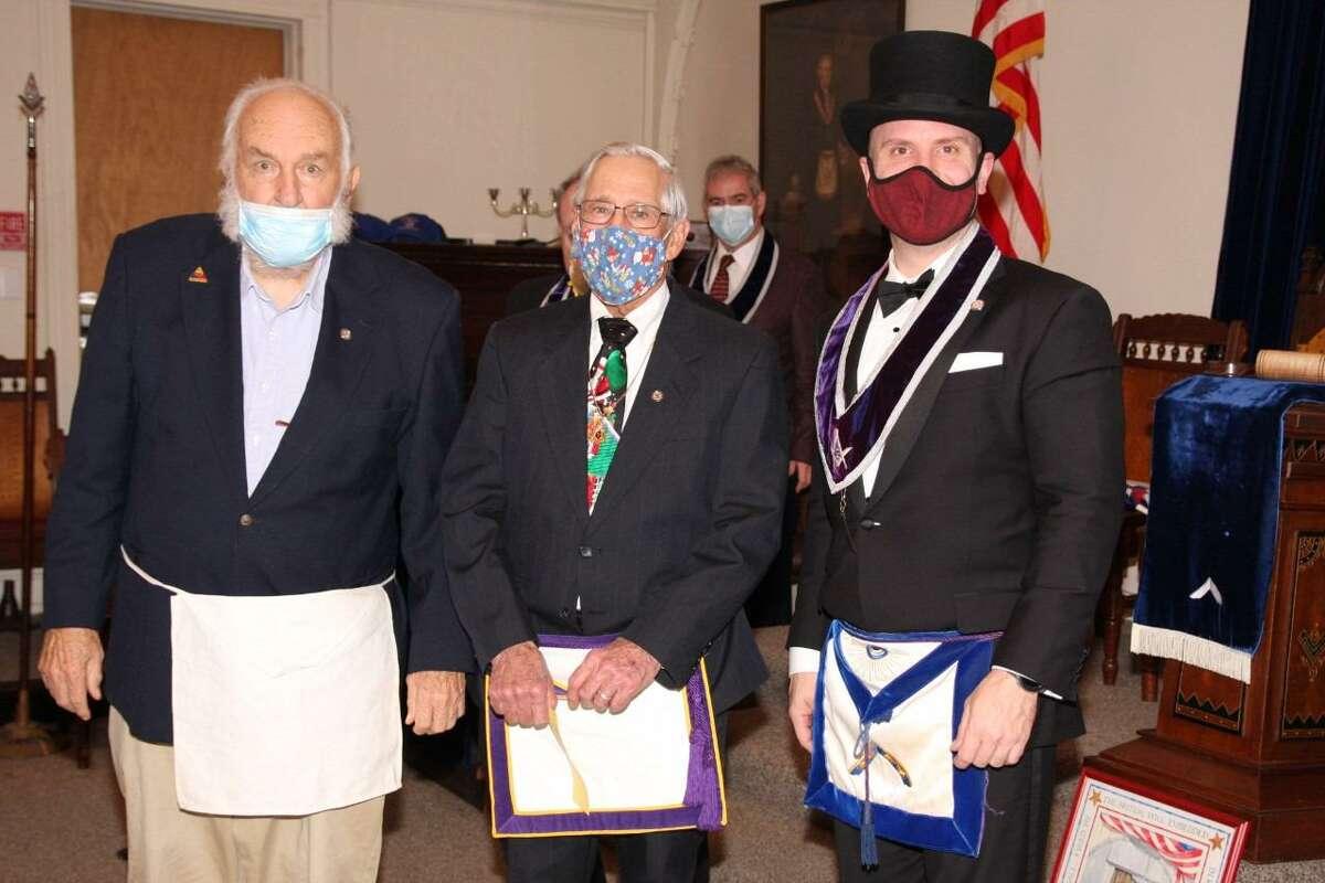 Bro. Willard Carter, RW Bro. Walt Wieland, and WM Steve Dudzic. Treasurer Charles O'Neill looks on in the background.