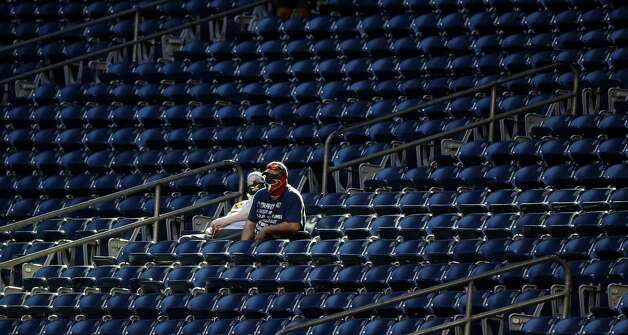 Houston Texans fans in a ray of sunshine before the start of an NFL football game Sunday, Jan. 3, 2021, at NRG Stadium in Houston . Photo: Karen Warren/Staff Photographer / © 2021 Houston Chronicle