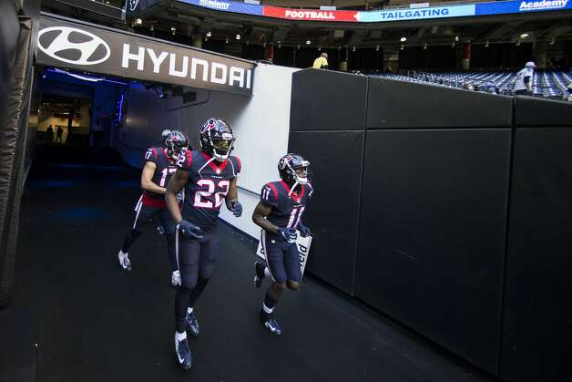 Houston Texans cornerback Gareon Conley (22), wide receiver Chad Hansen (17) and wide receiver Steven Mitchell (11) run through the tunnel to warm up before an NFL football game at NRG Stadium on Sunday, Jan. 3, 2021, in Houston. Photo: Brett Coomer/Staff Photographer / © 2021 Houston Chronicle
