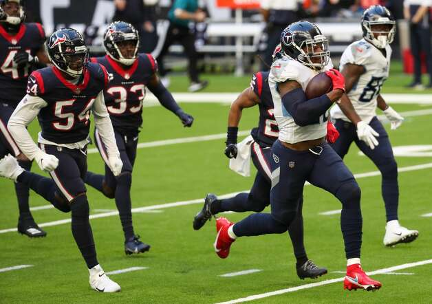 Tennessee Titans running back Derrick Henry (22) breaks past the Houston Texans defense for a 52-yard touchdown run during the second quarter of an NFL football game at NRG Stadium on Sunday, Jan. 3, 2021, in Houston. Photo: Brett Coomer/Staff Photographer / © 2021 Houston Chronicle