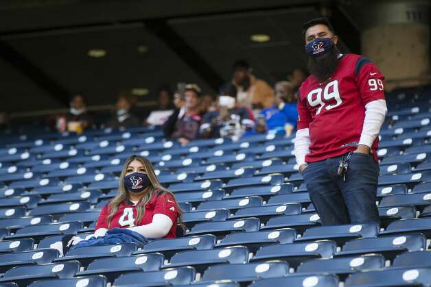 Houston Texans fans watch the Texans and Tennessee Titans warm up under the open roof before an NFL football game at NRG Stadium on Sunday, Jan. 3, 2021, in Houston. Photo: Brett Coomer/Staff Photographer / © 2021 Houston Chronicle