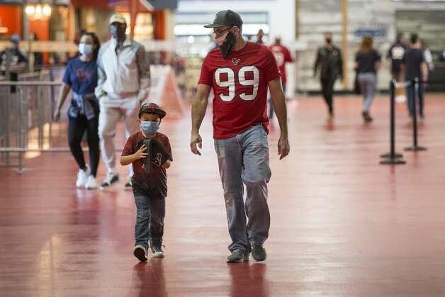 Houston Texans fans walk along the concourse before an NFL football game at NRG Stadium on Sunday, Jan. 3, 2021, in Houston. Photo: Brett Coomer/Staff Photographer / © 2021 Houston Chronicle