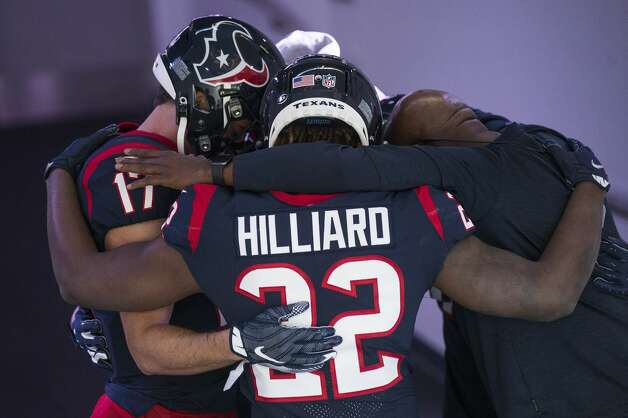 Houston Texans cornerback Gareon Conley (22) and wide receiver Chad Hansen (17) embrace to say a prayer before an NFL football game at NRG Stadium on Sunday, Jan. 3, 2021, in Houston. Photo: Brett Coomer/Staff Photographer / © 2021 Houston Chronicle