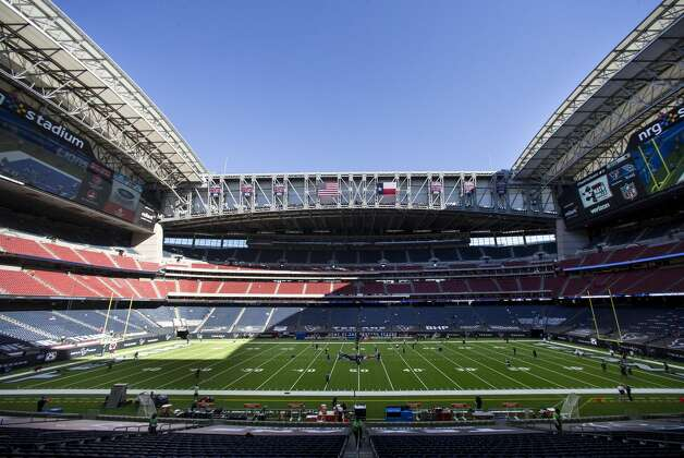The Houston Texans and Tennessee Titans warm up under the open roof before an NFL football game at NRG Stadium on Sunday, Jan. 3, 2021, in Houston. Photo: Brett Coomer/Staff Photographer / © 2021 Houston Chronicle