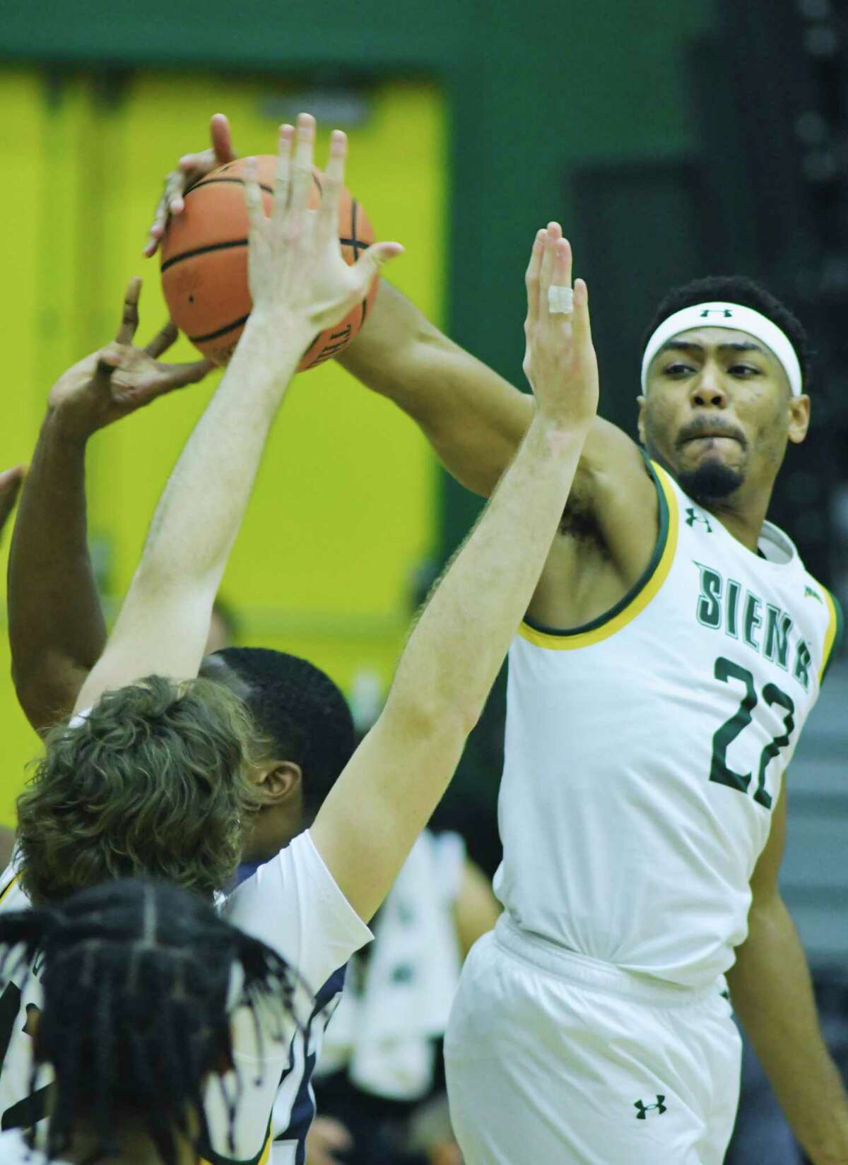 Jalen Pickett of Siena knocks the ball out of the hand of a Monmouth player during their game at the Alumni Recreation Center on the campus of Siena College, on Sunday, Jan. 3, 2021, in Loudonville, N.Y. (Paul Buckowski/Times Union)