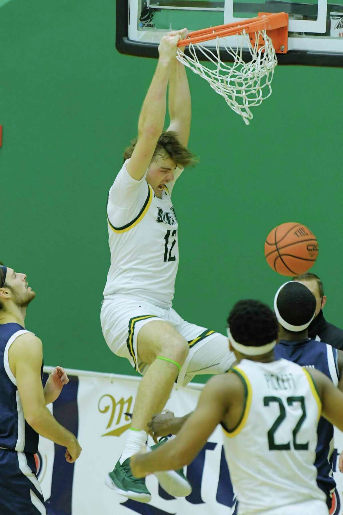 Kyle Young of Siena dunks the ball during their game against Monmouth at the Alumni Recreation Center on the campus of Siena College, on Sunday, Jan. 3, 2021, in Loudonville, N.Y. (Paul Buckowski/Times Union)