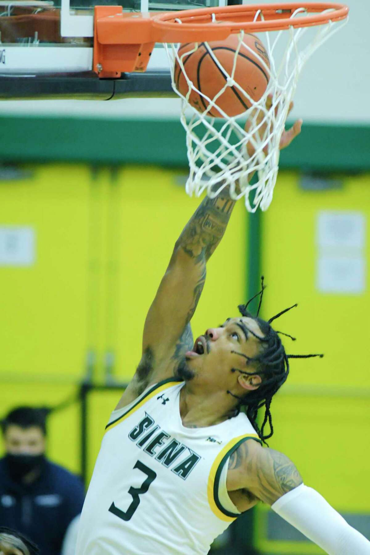 Manny Camper of Siena scores during their game against Monmouth at the Alumni Recreation Center on the campus of Siena College, on Sunday, Jan. 3, 2021, in Loudonville, N.Y. (Paul Buckowski/Times Union)