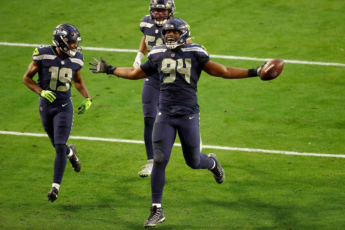 GLENDALE, ARIZONA - JANUARY 03: Defensive end Rasheem Green #94 of the Seattle Seahawks celebrates alongside Penny Hart #19 and Jordyn Brooks #56 after a fumble recovery against the San Francisco 49ers during the second half of the NFL game at State Farm Stadium on January 03, 2021 in Glendale, Arizona. (Photo by Christian Petersen/Getty Images)