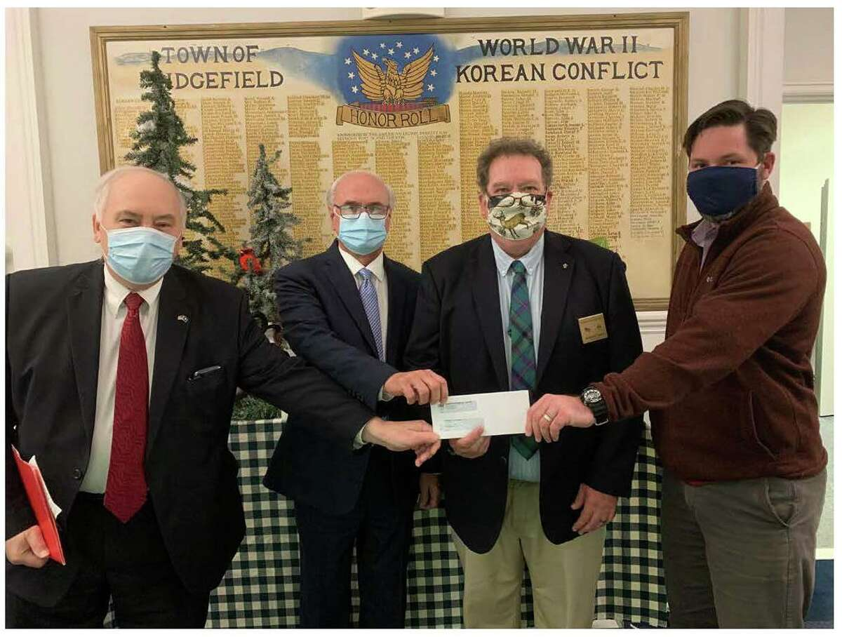 Danbury Elks Lodge #120 recently presented the Ridgefield Food Pantry with a donation of $1,750 to assist in serving people in need in the surrounding communities during the current difficult times of the coronavirus pandemic. The Benevolent and Protective Order of Elks, (BPOE), is a National Fraternal Organization established in 1868. It currently with 2000 lodges across the U.S. with a million members, whose mission is community welfare, and promoting American patriotism through local, and National programs, and grants. Pictured left to right are: Loyal Knight Alex Karsanidi, Ridgefield First Selectman Rudy Marconi, Exalted Ruler Ray Ward, and Director Social Services Tony Phillips.