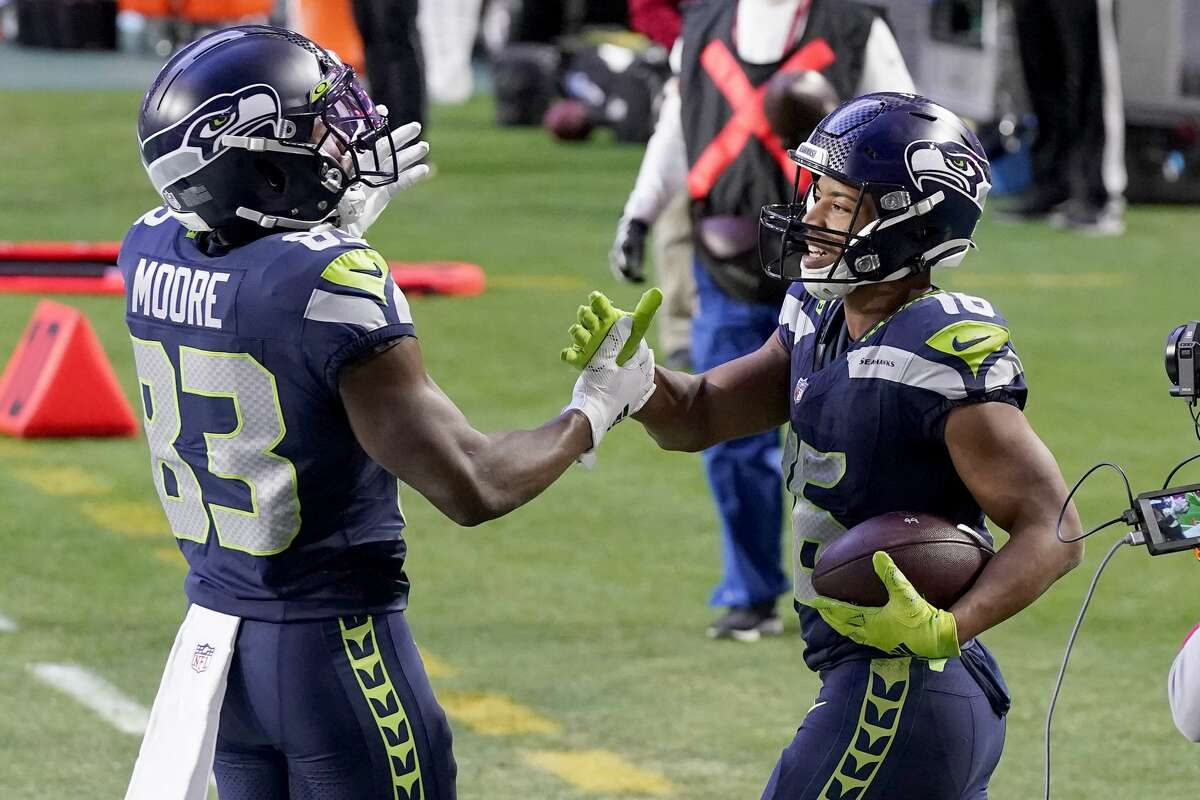 Seattle Seahawks wide receiver Tyler Lockett (16) celebrates his touchdown during the second half of an NFL football game against the San Francisco 49ers with wide receiver David Moore (83) , Sunday, Jan. 3, 2021, in Glendale, Ariz. (AP Photo/Ross D. Franklin)