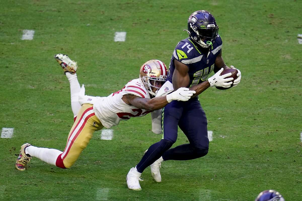 Seattle Seahawks wide receiver DK Metcalf (14) makes a catch as San Francisco 49ers cornerback Dontae Johnson defends during the first half of an NFL football game, Sunday, Jan. 3, 2021, in Glendale, Ariz. With the catch, Metcalf passed former Seahawk Steve Largent?'s single-season franchise record of 1,287 receiving yards set in 1985. (AP Photo/Ross D. Franklin)