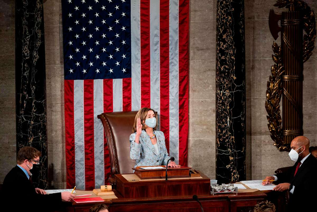 Speaker of the House Nancy Pelosi is sworn in on the House floor in the Capitol after winning another term, which could be her last. Pelosi narrowly defeated House GOP leader Kevin McCarthy of Bakersfield.
