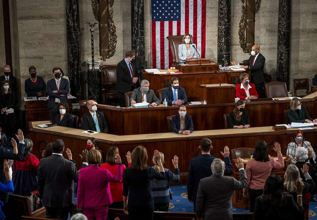 House Speaker Nancy Pelosi administers the oath of office to members of the 117th Congress at the U.S. Capitol on Sunday.