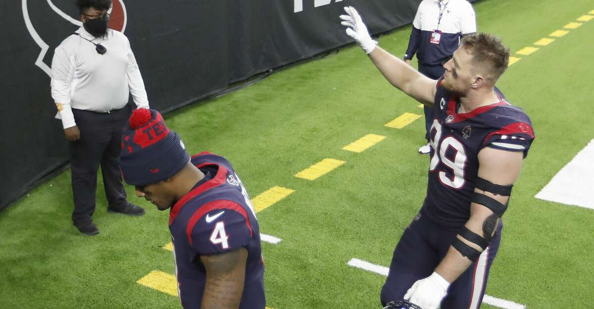 Houston Texans defensive end J.J. Watt (99) waves to fans as he and quarterback Deshaun Watson (4) walk back to the locker room together after their 41-38 loss to the Tennessee Titans during the fourth quarter of an NFL football game Sunday, Jan. 3, 2021, at NRG Stadium in Houston .