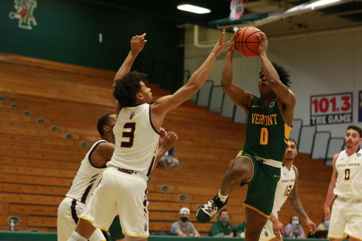 Vermont guard Stef Smith, a preseason all-America East selection, was held without a field goal by the UAlbany defense Sunday, Jan. 3, 2021, at Patrick Gymnasium in Burlington, Vt. Danes defenders include C.J. Kelly (15), Jojo Anderson (3), Mel Horton (12) and Antonio Rizzuto (0). (Nich Hall/UVM athletics)