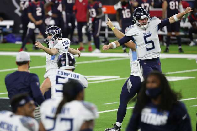 Tennessee Titans kicker Sam Sloman (2) and quarterback Logan Woodside (5) celebrate Sloman's 37-yard game-winning field goal to beat the Houston Texans during the fourth quarter of an NFL football game at NRG Stadium on Sunday, Jan. 3, 2021, in Houston. Sloman's kick, that bounced off the upright and wend in, to give the Titans a 41-38 win and the AFC South title. Photo: Brett Coomer/Staff Photographer / © 2021 Houston Chronicle