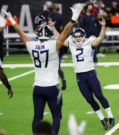 Tennessee Titans kicker Sam Sloman (2) and tight end Geoff Swaim (87) celebrate Sloman's 37-yard game-winning field goal to beat the Houston Texans during the fourth quarter of an NFL football game at NRG Stadium on Sunday, Jan. 3, 2021, in Houston. Sloman's kick, that bounced off the upright and wend in, to give the Titans a 41-38 win and the AFC South title. Photo: Brett Coomer/Staff Photographer / © 2021 Houston Chronicle